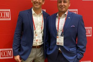 Tom Ellixson and Jason Triano after they received the CCIM designation